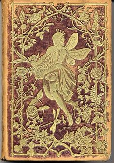 Fairytale Style and Inspiration... antique gilded book cover with a fairy and floral design