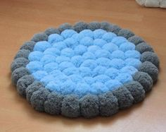 This heart rug is the softest rug you can imagine. It consists of over 70 pieces of big 4 (10 cm) yarn pom poms made of very thin acrylic yarn. The thickness of the rug is over 3,4 (8cm) - a few times more than any other rug. Each pom pom is twice sewed to the rug bottom to assure the durability. Its a unique decoration for a nursery or small princess room. You can choose from the following colors: - delicate pink, - pink, - intensive pink, - fuchsia and dark gray. If you wish to order…