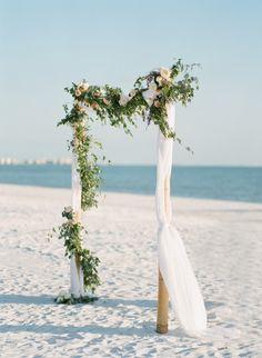 Organic floral topped beach wedding arbor: http://www.stylemepretty.com/florida-weddings/fort-myers/2016/02/15/sweet-organic-florida-beach-wedding/ | Photography: Jody Savage Photography - http://jodysavagephotography.com/