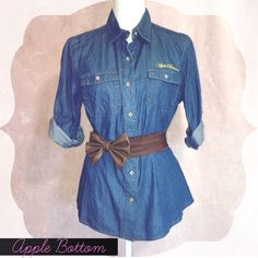 """1 Hour Sale✨Apple Bottom Jean Blouse✨ Apple Bottom blouse. Beautiful classic blue, buttons down. The blouse has two front pockets. Apple Bottom emblem on the back neck area. Sleeves can be unbuttoned. (Belt not included)  Measures: Pit to pit: 19""""  Content: 100% cotton  ▪️Never Worn ▪️Smoke/Pet free No Trade ▪️Like the Item not the Price? Make an Offer   below Apple Bottoms Tops Blouses"""