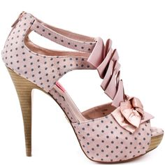 You'll be a style icon in your home town with this sexy cut out pump from Betsey Johnson. Iconn has a grey and pink polka dot print satin upper, with pink ruffled ribbon detail and satin bow at the vamp. Help your pedicure stand out with this intriguing 1 inch platform and 5 inch heeled peep toe.