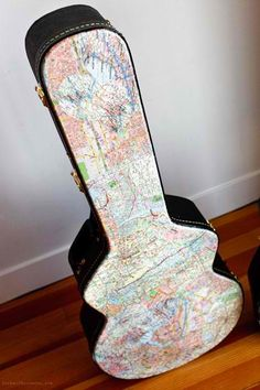 decoupage a guitar case with maps...do this with a ukulele case!