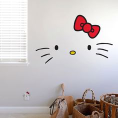 Maybe paint a white square on H's wall...some clouds I the upper part then put a big frame around it & hello kitty could be peeking in.