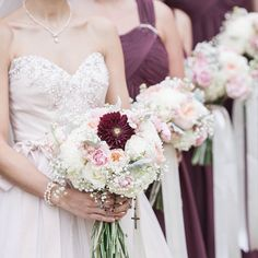A blush and pink bouquet with hints of cranberry colored dahlias. A way to add a pop of color to the popular blush bouquets. And yes that is a blush wedding dress!  Floral Design: @allgrandevents  Photo: T.E.P. Studios Venue: @michiganstateu by allgrandevents