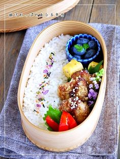 Chicken cutlet, omelet with white sesame, blueberries, and rice.