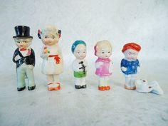 Six Vintage Frozen Charlotte Dolls - Set of Six Japan Bisque Penny Dolls - Vintage Bisque Bride and Groom Cake Topper. $116.00, via Etsy.