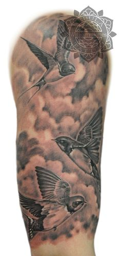 Swallows and clouds half sleeve, done by William Jones