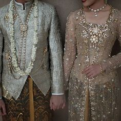 Bride & Groom #wedding attire in #askyfebrianti  #kebaya #kutubaru #beskap #surjan Makeup by @nanathnadia