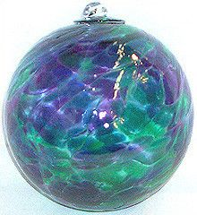 "Swirling colors of purple, green, and blue. 4"" diameter."