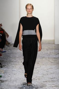 "<p tabindex=""-1"" class=""tmt-composer-block-format-target tmt-composer-current-target"">Public School Spring 2015, Look 12: This otherwise basic sweater is given a cool update with the cape-like sleeves that fluttered behind Hanne Gaby as she walked."