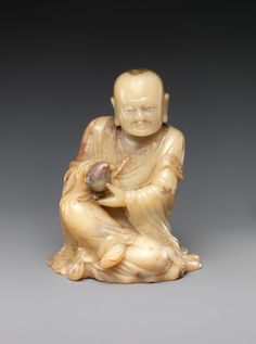 Buddhist disciple, or luohan, holding a peach. Period: Qing dynasty (1644–1911). Date: 17th century. Culture: China. Medium: Soapstone.