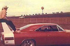 Daytona at Talladega. Sitting on the wing with your boots on the car? What a way to watch the race! 1969 Dodge Charger Daytona, Dodge Daytona, Plymouth Superbird, Plymouth Cars, Dodge Muscle Cars, Car Photos, Dodge Chargers, Dream Cars, Vintage Iron