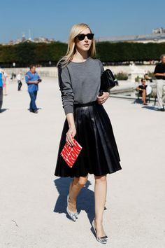 Jane Keltner de Valle of Teen Vogue brings edge to traditional lady-like dressing with a pleated leather midi-skirt, shiny silver pumps, and...