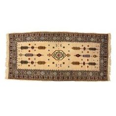 """Vintage Tunisian wool rug in beige with multicolor accents.  Product: RugConstruction Material: WoolColor: Cream, blue, brown and greenFeatures: Made in IranDimensions: 7'6"""" x 3'5""""Note: Due to the vintage nature of this product, minor wear and tear is to be expected. Products may show signs of brand marks, scrapes or other blemishes."""