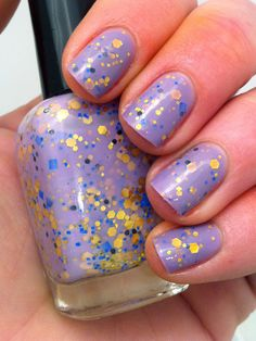 "Nail polish - ""Regal beginnings"" gold, blue and black glitter in a light purple base. $10.00, via Etsy."