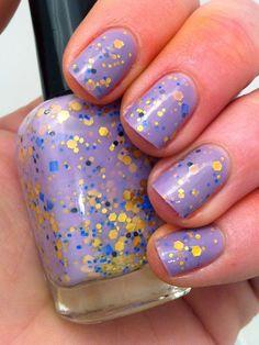 "Nail polish - ""Regal beginnings"" gold, blue and black glitter in a light purple base. $10.00, via Etsy."