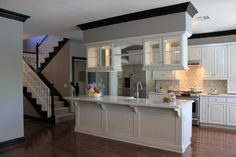 Love the cabinets above the island.