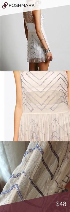 "flash sale Free People embellished slip dress Pretty!  lavender beads on the palest peach mesh sheer slip dress, has a couple tiny loosening threads but in great condition otherwise (see pic 3) Perfect for the holidays! 33"" long (4th pic shows a faded dot by the left corner near the beads on the other side) Free People Dresses"