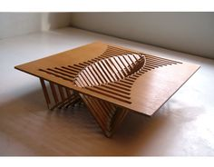 """""""By emphasing nature's logic, a seemingly random collection of wooden beams organically merges to form the figuratively beating heart of the Rising Table."""""""