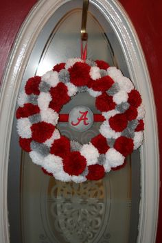 Alabama Roll/Crimson Tide Team Spirit Pom Pom Yarn Wreath.  On ETSY they want 75.00 for this.  HA!! I can make it for about 5.00.