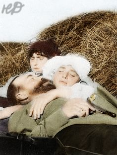 Tsar Nicholas II resting in the sunshine with his two youngest daughters, Grand Duchess Marie and Grand Duchess Anastasia