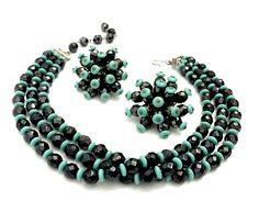 Atomic Turquoise & Black Bead Demi  Measures: Approx. Necklace 14L (can easily add an extender)   Earrings 1 3/4  Mark: None  Condition: Very Good vintage condition  This is a rare, fabulous, and funky set is in pristine condition. It looks like it has been packed away for years and never worn. Highly faceted black glass crystal beads and turquoise glass spacers are hand wired into this amazing choker and large Sputnik clip-on earrings. We just love this fun unique c.1950s vintage s...