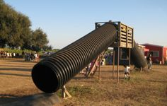 A slide made out of what looks like culvert pipe