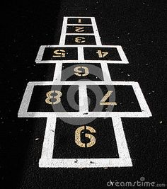 The game of hopscotch painted on the asphalt of an elementary school playground