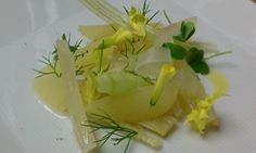 one spoon quenelle: dairy free cheese course replacement - candied fennel with vanilla, compressed granny smith apples, celery ribbons, wood leaves and flowers, celery leaves, fennel fronds, and olive oil.