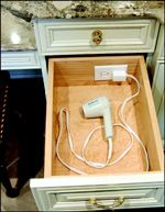 This would be just as easy with a small power strip. Drill a hole in the back of the drawer big enough to feed the plug thru and plug it in behind the dresser. Use 3M Command Strips or Velcro to attach power strip to inside back of drawer. More outlets and easier to find parts.