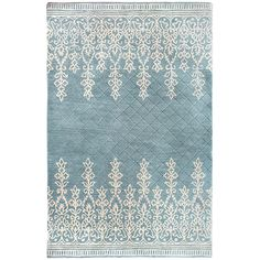 I like this one even better! I think it may be in stock at the Vero Store! Kushi Border Rugs - Light Blue