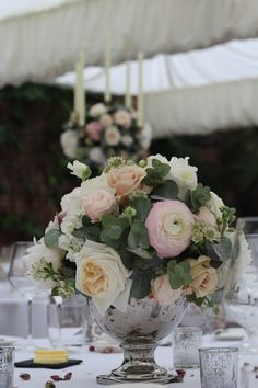 Silver Candelabra flower balls and silver Rose Bowl guest table arrangements filled with white Hydrangea, Scented stocks, sweet peas, Peonies, blush Ranunculus, Quicksand Roses, Bombastic Roses, scented Garden Roses, designed and created by www.hannahberryflowers.co.uk for a wedding at Northbrook Park located in Farnham Surrey #romantic and #blush #wedding #flowers