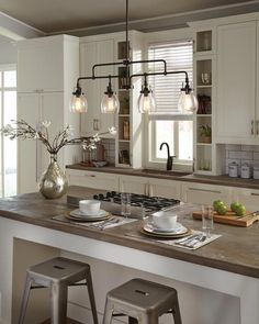 vintage industrial design, the transitional Belton lighting collection by Sea Gull Lighting has Seeded glass shades that highlight the classic Edison bulbs. Ideal for kitchen island lighting. Home Decor Kitchen, New Kitchen, Home Kitchens, Kitchen Dining, Kitchen Cabinets, Awesome Kitchen, Kitchen Ideas, Beautiful Kitchen, Stove Island Kitchen