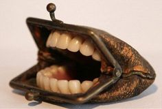 Gotcha....LOL!!!!!! Recycle a change purse & old set of false teeth....