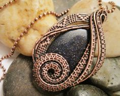Oxidized Copper Wire Woven Blue Goldstone Pendant