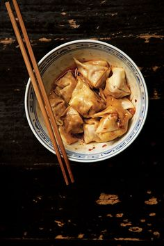 "Sichuan Pork Wontons (Chao Shou) 1 1⁄2 lb. ground pork 3 tbsp. cornstarch 2 tbsp. dry sherry 2 tbsp. light soy sauce 1 tbsp. Chinese rice wine 4 cloves garlic, minced 40 (3 1⁄2"") square wonton wrappers 1 egg, beaten 1⁄2 cup hong you (Sichuan red chile oil or use store-bought), plus more for serving 2 tbsp. Chinkiang black vinegar, plus more for serving 1 (4"") piece of ginger, peeled and minced Kosher salt, to taste"