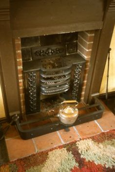 By the early century, most Georgian and Victorian coal-burning fireplaces had a cast iron hob grate with iron surfaces to one of both sides of the grate. Most rooms had a fireplace, though those in the bedrooms were rarely used. Georgian Fireplaces, Houses In Ireland, East Street, Fireplace Inserts, House Renovations, A Christmas Story, Ds, Cast Iron, Abandoned