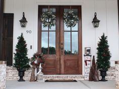 """Old Time Pottery on Instagram: """"Create a Christmas front porch that will sleigh the season! Choose from hundreds of affordable outdoor décor options that will help you…"""" Large Christmas Tree, Christmas Wreaths To Make, Beautiful Christmas Trees, Prim Christmas, Christmas Lights, Gingerbread Decorations, Outdoor Christmas Decorations, Outdoor Decor, Old Time Pottery"""