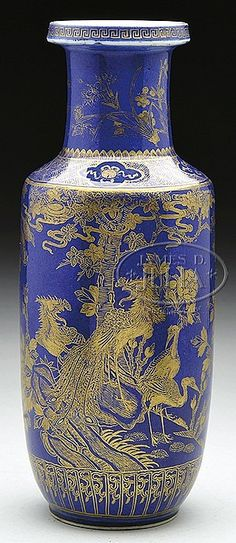 "ROULEAU FORM PORCELAIN VASE. 19th century, China. Blue with gilt decoration of birds and flowers. SIZE: 12"" h."