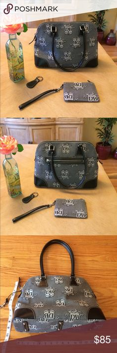 "👛 Dooney & Bourke; Lg. Doctor's Bag Purse Newish! Barely used! Dooney & Bourke, Black & Gray Doctor Bag Style Signature Fabric w/Leather Purse! Includes a Zippered Pouch with Key Ring (4""x 6""), & another Key Chain for your House/Car Keys. See inside label in photo for Authenticity. This Bag is Large! Measurements are approx. 14 1/2"" across, Height is approx. 10"" + another 9"" to the top of the handle. Width is approx. 5"" at the largest part, however, this bag is very stuffable! Can carry…"