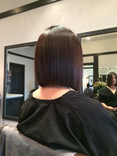 Blunt haircut. Sleek straight asian hair.