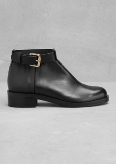 & Other Stories | Buckle Leather Boots. Elegant and classic, these low-ankle leather boots feature an ankle strap with a shiny metal buckle.