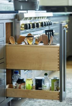 A Drawer Next To The Range Opens To Reveal Handy Storage For Cooking  Utensils And Frequently