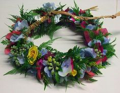 "A fresh floral ""haku"" head lei"