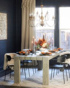 All ready for fall.... @idreamofhomemaking has created a dreamy dining space with a gorgeous tables cape below our Auburn chandelier. It's walnut stain pairs with the gorgeous ceiling wood panels and black scrolling arms compliments the dark shiplap beautifully. #ceilingdesign #shiplap #falltablescape #ceilingplank #farmhousediningroom #diningroom #ceilingwood #diningroomdecor #ceilingfarmhouse #ceilingDIY #farmhousediningroomlighting #shiplapfarmhouse #diningroomtable…
