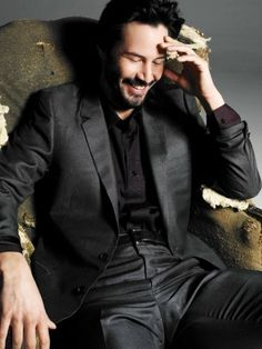 Keanu Reeves - he doesn't smile much, but when he does...