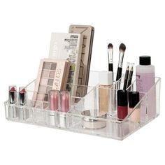 This crystal-clear organizer displays beautifully on your bathroom vanity and has ample compartments to fit a multitude of cosmetic items. The clear acrylic and sleek design allows you to find everything with ease. Stackable with the standard and tall drawers from this line to create your own custom makeup station. Made in USA.