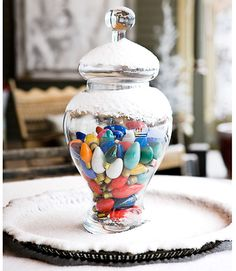Light Up A Room With Color    Brighten a room with colorful bulbs. Even unplugged lights shine when gathered in a glass apothecary jar. For a container that truly glistens, top it off with a dusting of artificial snow.