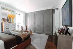 Paint colors that match this Apartment Therapy photo: SW 2838 Polished Mahogany, SW 6990 Caviar, SW 7505 Manor House, SW 0077 Classic French Gray, SW 7661 Reflection