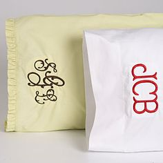 Embroidered monogram on pillow cases. There is a local lady I could get to do this I bet ;) Would make a sweet gift for a couple getting married.